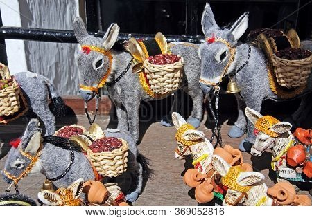 Souvenir Donkeys Displayed Outside A Shop In The Village, Mijas, Costa Del Sol, Malaga Province, And