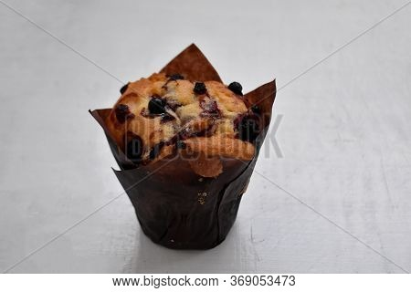 Freshly Baked Delicious Homemade Sweet Blueberry Muffin On A Table.
