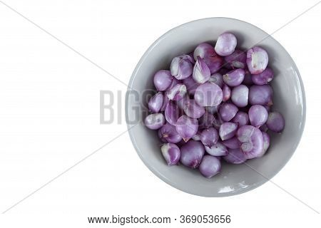 Peeled Whole Shallot In A Bowl Isolated On White Background Included Clipping Path.