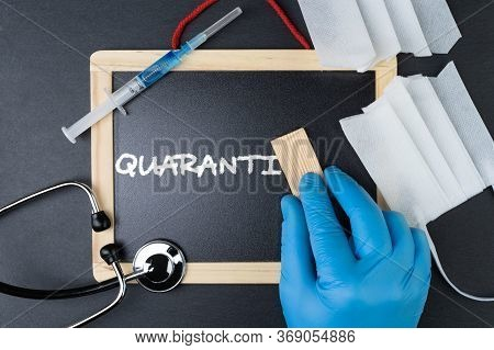 Blackboard With Stethoscope, Syringe With Vaccine And Cut Face Mask. Hand In Protective Glove Erasin