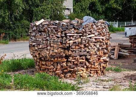 A Large Number Of Firewood Beautifully Stacked Into A Woodpile