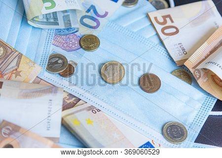Medical Face Mask And Money On A Black Background. World Coronavirus Epidemic And Economic Losses Co