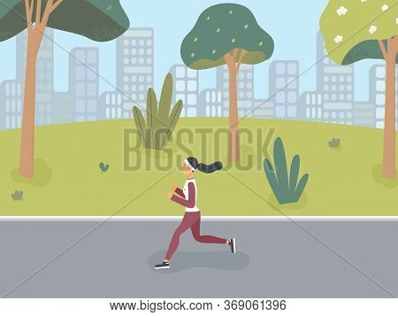 Happy Girl Dressed In Sportswear Jogs In A Spring Or Summer Park In Order To Lead A Healthy Lifestyl