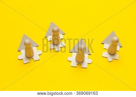 Wooden Figures Working Online In House On Yellow Background. Freelance Workplace At Home, Teleworkin