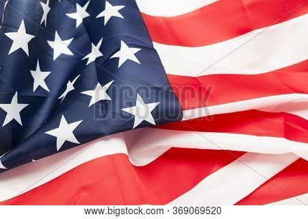 Usa Flag Background With Creases Developing In The Wind. American Independence And Freedom.