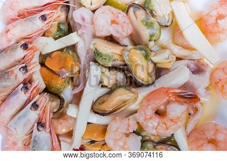 Different Cooked Seafoods - Shrimps, Prawn Tails, Mussels Peeled From Shells, Calamari Slices On The