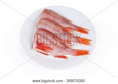 Uncooked Headless Gutted Carcasses Of Redfish Also Known As Ocean Perch Or Norway Haddock On The Whi