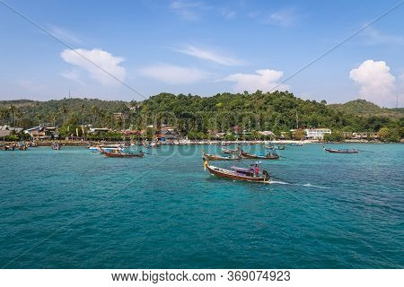 Longtail Boats At Ao Tonsai Pier At Phi Phi Islands, Krabi Province, Thailand