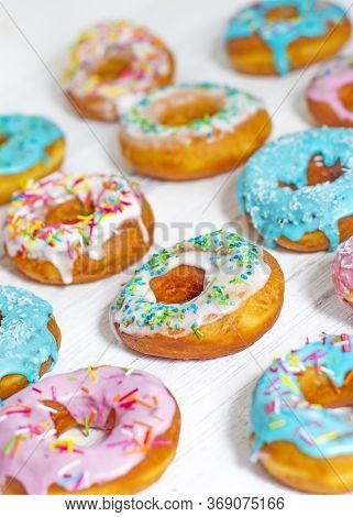 Colorful Donuts Turquoise And Pink, Pattern. Donuts Set On White Background. Doughnuts With Multi Co