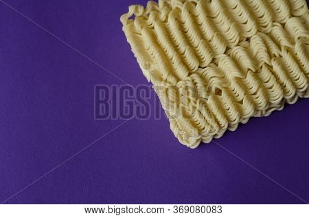 Instant Vermicelli On A Blue Background. Close-up Rectangle Of Dry Instant Noodles. Fast Junk Food.