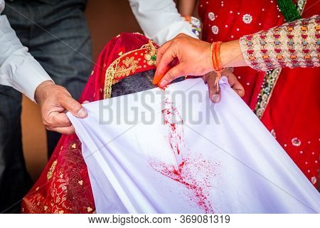 The Groom Applies Sindoor Or Vermilion To The Bride As A Symbol Of Marriage According To Hindu Ritua