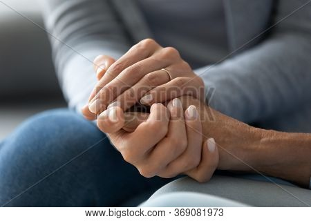 Closeup Caring Adult Daughter Holding Mothers Hand Provides Psychological Support