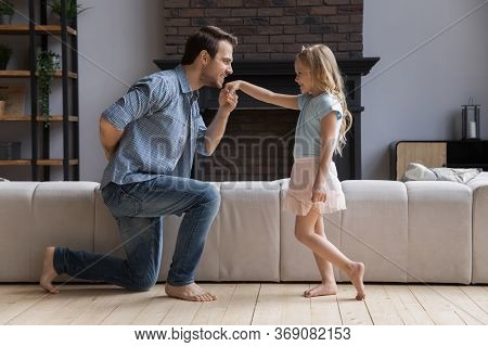 Loving Father Kneel Kiss Little Daughter Hand