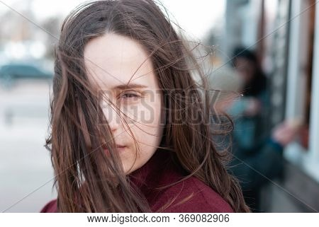 Portrait Of Beautiful Young Woman With Wind Fluttering Hair. Closeup Face Of Healthy Young Woman. Сo