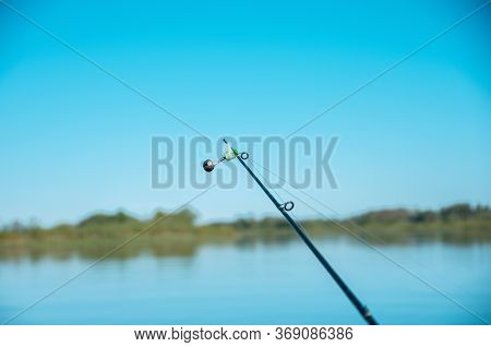 Fishing Rod With Bell On Lake, Blue
