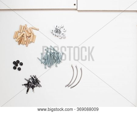 Furniture Assembly Parts Tie Screws And Wooden Dowels, Copy Space