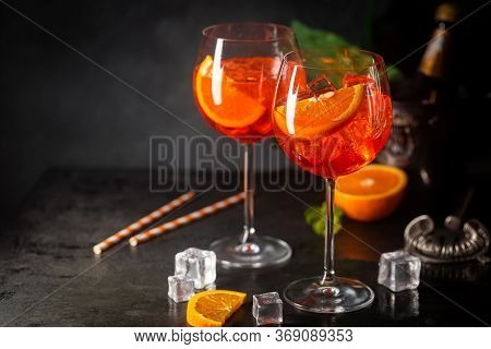 Aperol Spritz Cocktail In Glass With Fresh Orange On Dark Background