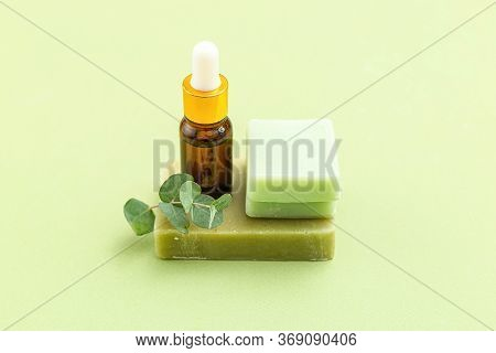 Soap, Eucalyptus And Serum On Green Backgriund. Skin Care. Minimalism