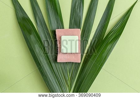 Pink And Green Natural Soap On  Palm Tree. Minimalism. Still Life