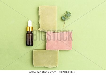 Soap Green And Pink Color With Eucalyptus And Serum On Green Backgriund. Skin Care. Minimalism