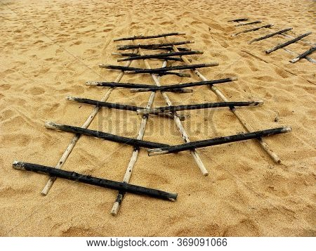 Wood Grate. Wooden Fixture For Storing Fishing Boats On The Shore.