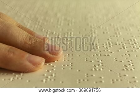 Braille Reading. Blind Woman Reads A Book In Braille