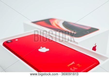 France, Paris - May 1, 2020: A New Red Apple Iphone Se 2nd Generation In A Box On White Background.