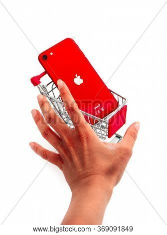 France, Paris - May 15, 2020: New Red Apple Iphone Se 2nd Generation In A Push Cart On White Backgro