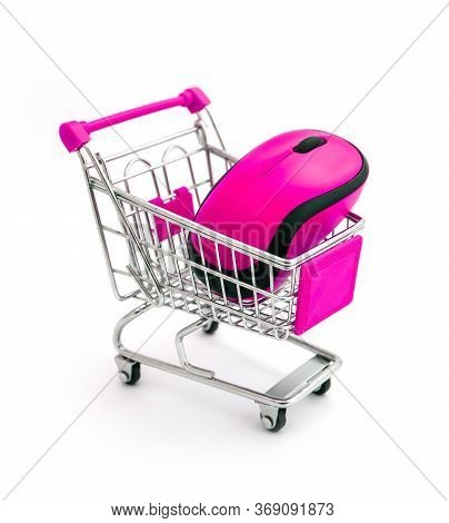 Glamour Pink Computer Wireless Mouse In Shopping Trolley Isolated On White.
