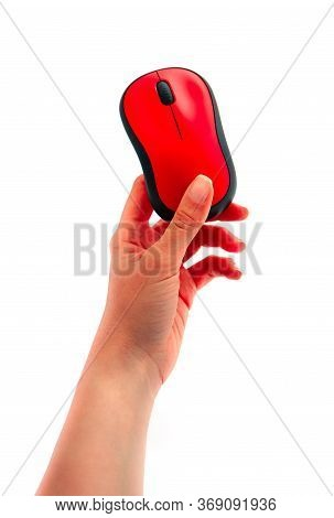 A Hand Holding A Red Wireless Computer Mouse, Isolated On White Background.