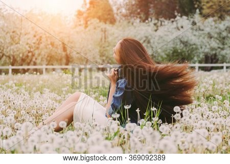 Back View Beautiful Carefree Hipster Woman Posing With Her Long Healthy Hair In Motion On Blossom Co