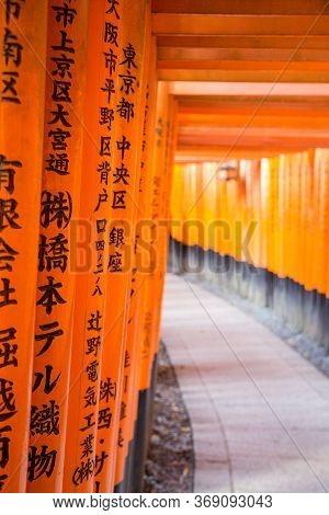 Kyoto, Japan - December 13, 2014: Orange Gates Called Torii At The Fushimi Inari Shrine