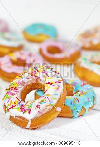 Colorful Donuts Turquoise And Pink On White Background Close-up. Doughnuts With Multi Colored Glaze.
