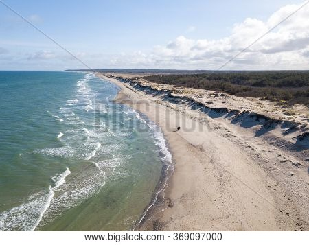 Liseleje, Denmark - April 4, 2020: Aerial Drone View Of The Beach, Sand Dunes And Forest.