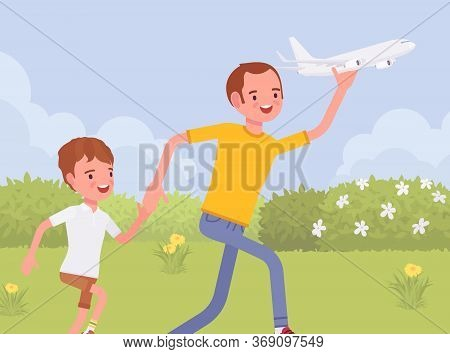 Happy Family, Father And Son Playing With Toy Airplane. Parent With Child Running Outdoor Holding Ae