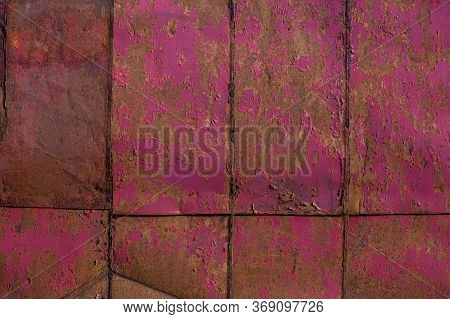 Rusted Tin Sheets Patchwork Wall Texture And Flat Background With Peeling Leftovers Of Pink Paint
