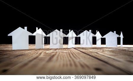 Paper chain neighborhood community, row of cut out model houses