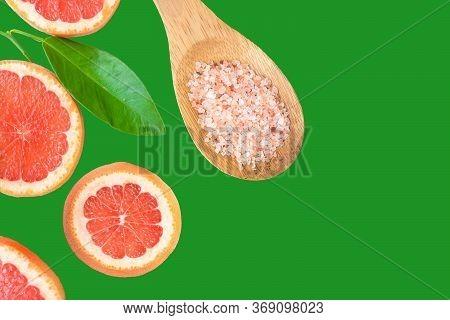 Ayurveda Face Skin Scrub Ingredients Himalayan Salt In Wooden Spoon Sliced Grapefruit On Green Backg