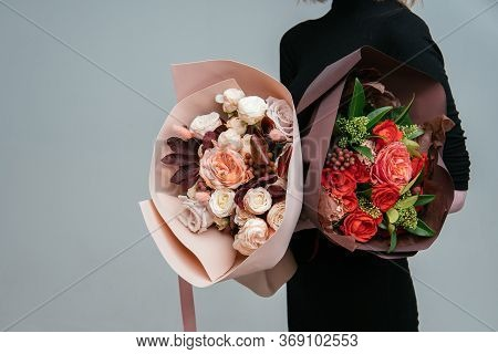 Bouquet Of Flowers In Burgundy Package And Bouquet Of Flowers In Peach Foamiran Package In The Hands