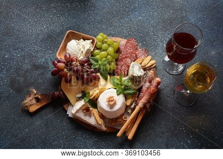 Appetizers Table With Snacks. Antipasto  Cheese Board, Salami And Prosciutto Crudo With Grissini Bre