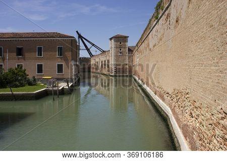 Venice, Italy - May 28 2016: Rio De Le Vergini In Venice, With The Historic Arsenal Walls