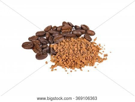 Pile Of Roasted Coffee Beans And Freeze Dried Instant Coffee On White Background