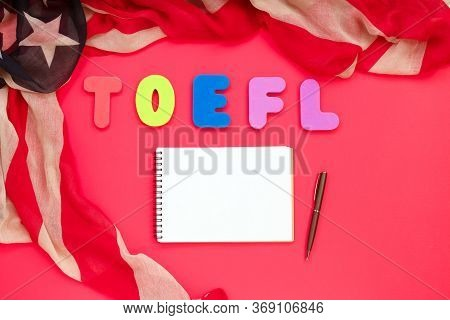 Word Toefl, American Flag And Notebook On Red Background. Usa Exam. Speaking English Language Concep
