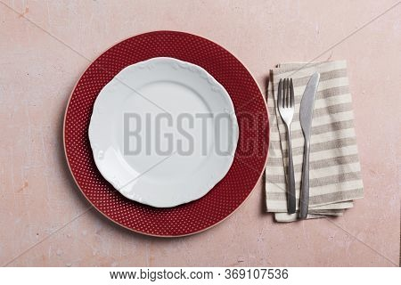 Table Setting With Silverware On Pink Concrete Background With Napkin. Top View, Flat Lay, Concept O