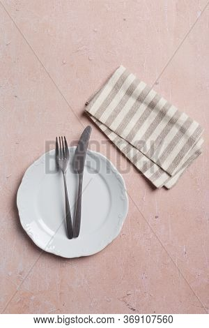 Object Table Set With Fork And Knife And Napkin On Pink Background. Minimal Serving Plate At Pink Co