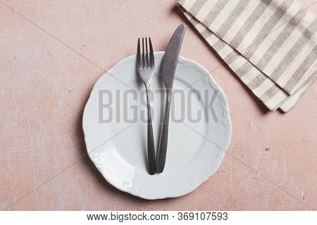 Table Set With Silverware On Pink Concrete With Napkin. Top View, Flat Lay, Plate For Text For Menu