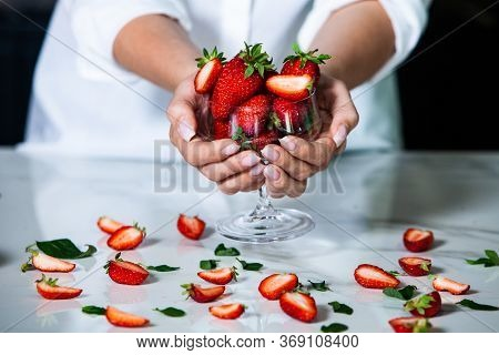 Glass Bowl With Fresh Strawberries Isolated. Strawberry Juice.  Close-up Of Strawberries In Someone\