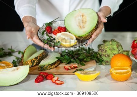 Closeup On Woman Making Fruits Salad. Preparing A Healthy Spring Fruit Salad. Happy Healthy Woman Cu