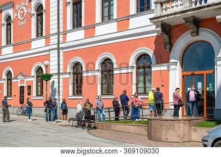 Ruzomberok, Slovakia - May 22, 2020: People In Face Masks Waiting In Line Due Social Restrictions Ag