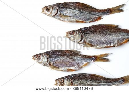 Dried Or Jerky Salted Roach, Palatable Clipfish Isolated On White Background. Salty Beer Appetizer.
